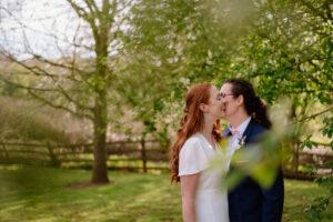Bride and Bride kiss at micro wedding in North Hampshire