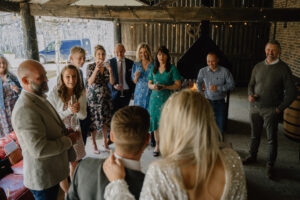 bride and groom share surprising news with wedding guests at East Yorkshire Barns micro wedding