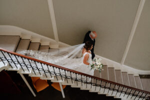 Bride and Father of the bride walking down Saltmarshe Hall staircase