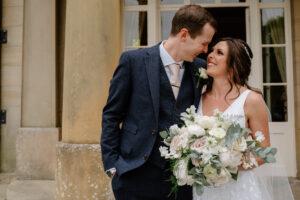 bride and groom smile at each other at micro wedding, Saltmarshe Hall